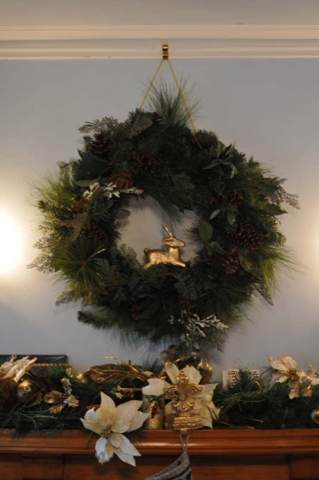 We love our little leaping reindeer in the wreath over the mantle.