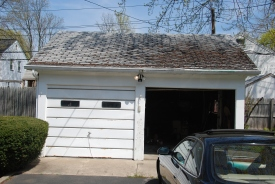Here's the front on the day we closed. Note the severely weathered shingles.